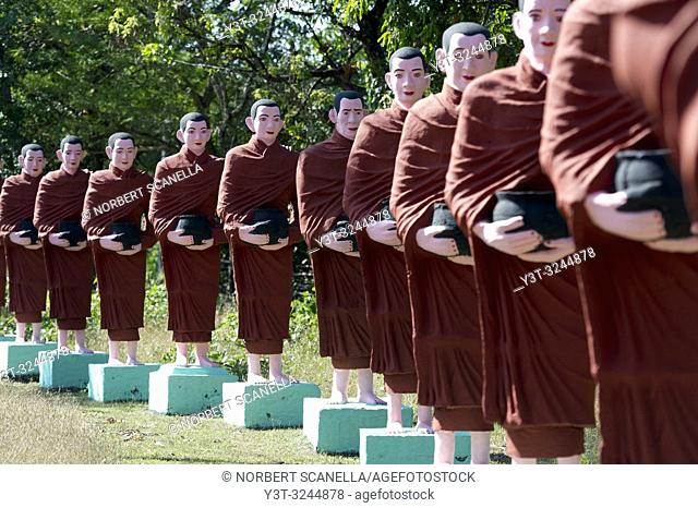 Myanmar (formerly Burma). Mon State. Yadana Daung Mawlamyine (Moulmein) surroundings, Win Sein Taw Ya temple. Row of statues of the 500 Arahant followers of...