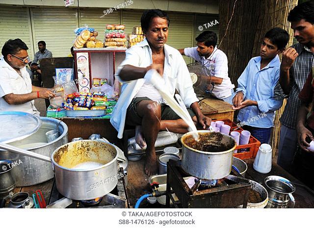 Man making tea on the street, New Delhi, India