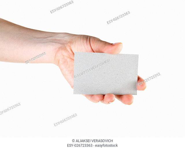 Blank business card in hand isolated on white background. Clipping path