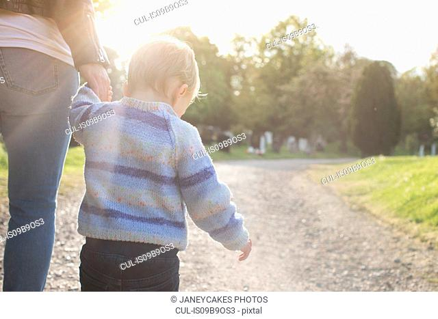 Mother and son taking walk
