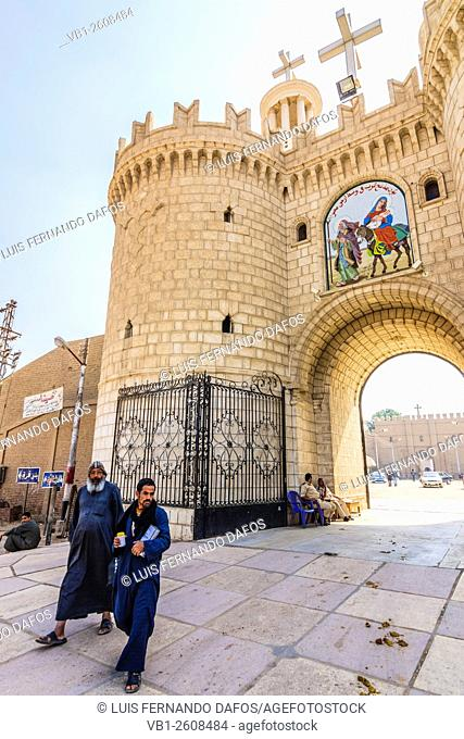 Coptic monks at the entrance of Deir al-Muharraq monastery. Egypt