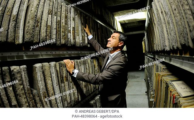 Bavarian Finance Minister Markus Soeder (CSU), examines the archive inventory during a press conference on the occasion of the 150th anniversary of the...