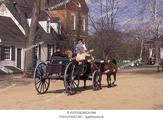 Colonial Williamsburg, VA, horse-drawn carriage, Williamsburg, Virginia, A team of horses pulling an open carriage carries tourists through the 18th century...