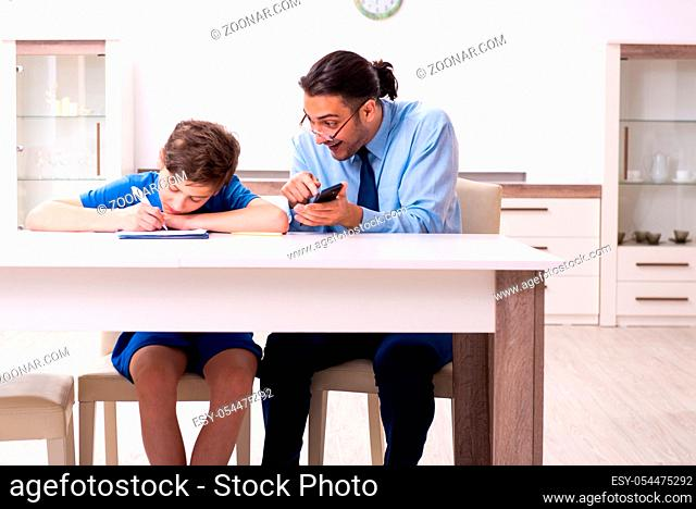 The busy father helping his son to prepare for exam