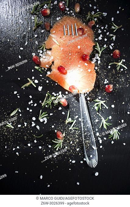 Presentation of salmon slice on black slate plate