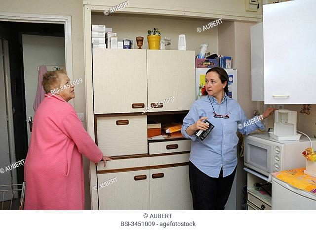 Independent nurse, in Vénissieux, France. Independent nurse at the home of a diabetic patient of type 1. The nurse will prepare the coffee