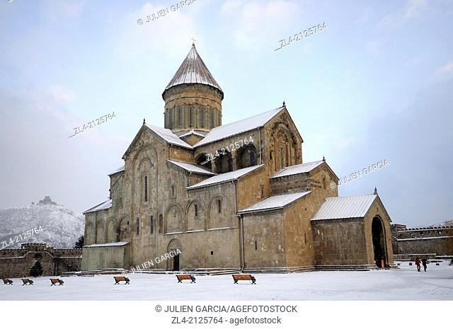 The christian orthodox cathedral of Svetitskhoveli covered with snow and Jvari monastery far on the hill. Georgia, Caucasus, Kartli, Mtskheta (ancient capital)