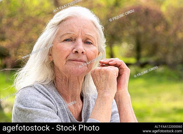 Senior woman sitting in garden
