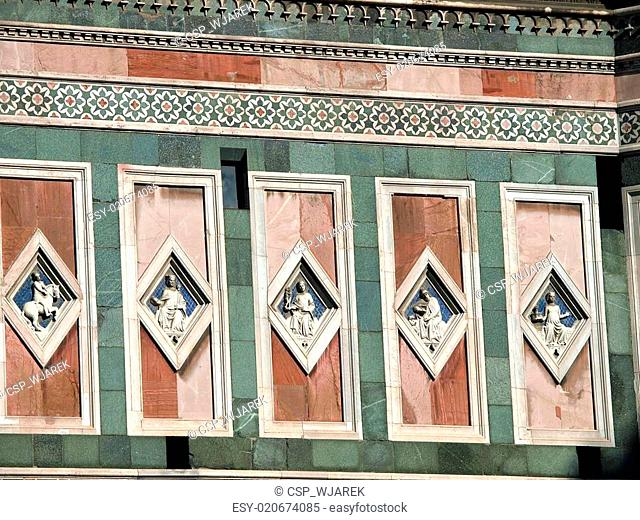Florence - marble panels with low relieves on one of walls of the Giotto's tower
