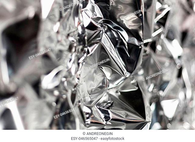 Full frame take of a sheeT of crumpled silver aluminum foil background