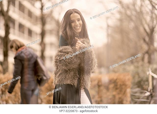 candid laughing woman wearing fashionable clothes in city, autumn season, Munich, Germany