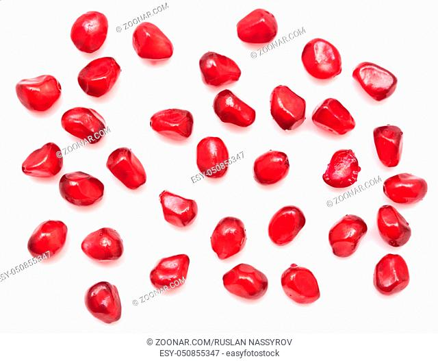 pomegranate seeds isolated on white background