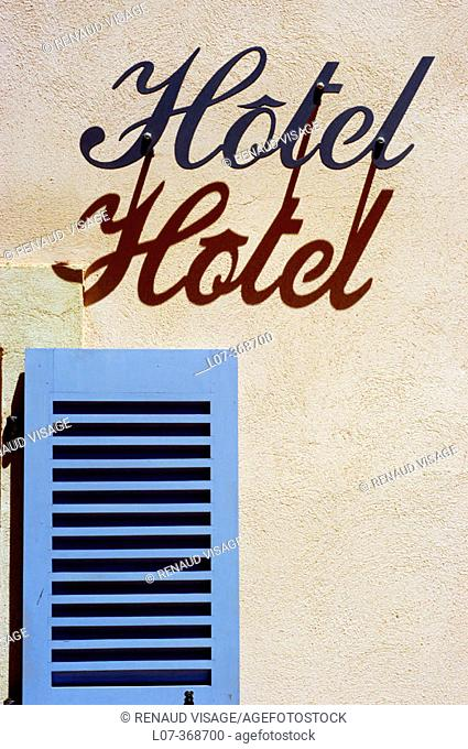 Hotel sign and blue shutter. Cassis. Riviera. France