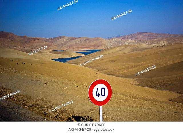 Speed limit sign in desert, Morocco