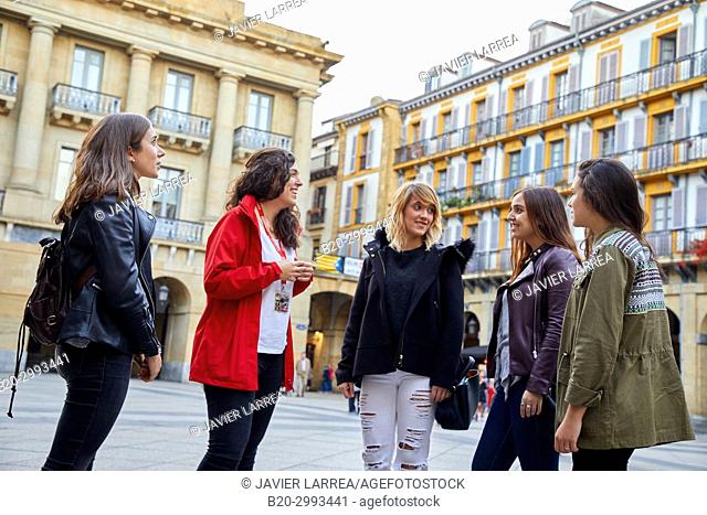 Group of tourists and guide making a tour of the city, Plaza de La Constitución, Old Town, Donostia, San Sebastian, Gipuzkoa, Basque Country, Spain, Europe