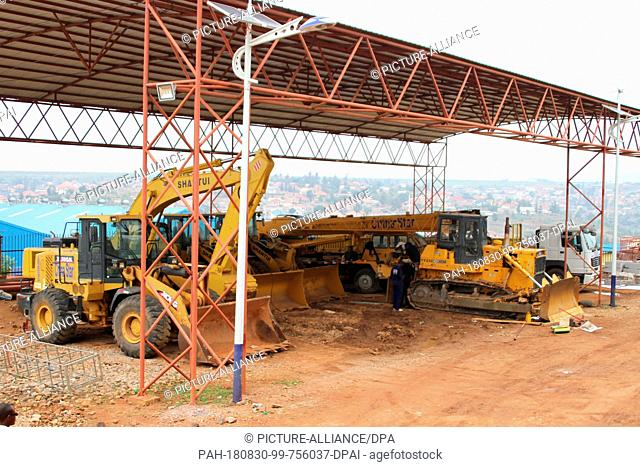 "28.08.2018, Rwanda, Kigali: Construction machinery from China Star Construction is available in the special trade zone. (On dpa """" The dragon in the land of the..."