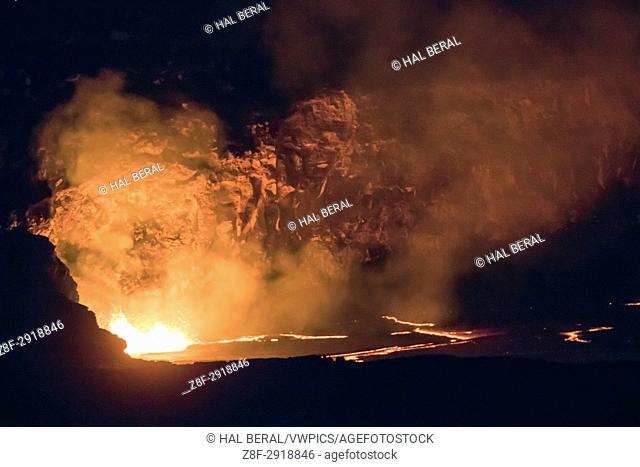 Molten lava in Kilauea Caldera fountains and lights the rim Hawaii Volcanoes National Park, Big Island,Hawaii