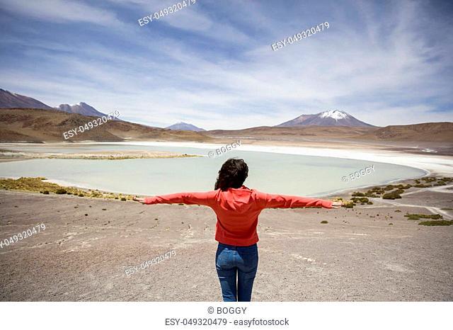 Young woman at Laguna Hedionda at Andean altiplano in Bolivia