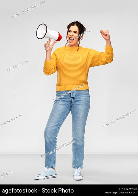 angry young woman speaking to megaphone