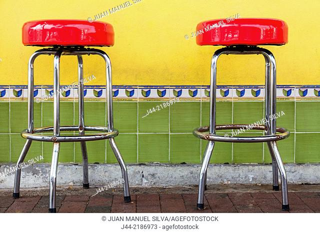 Red stools at outdoor restaurant, Littel Havan, Miami, Florida, USA