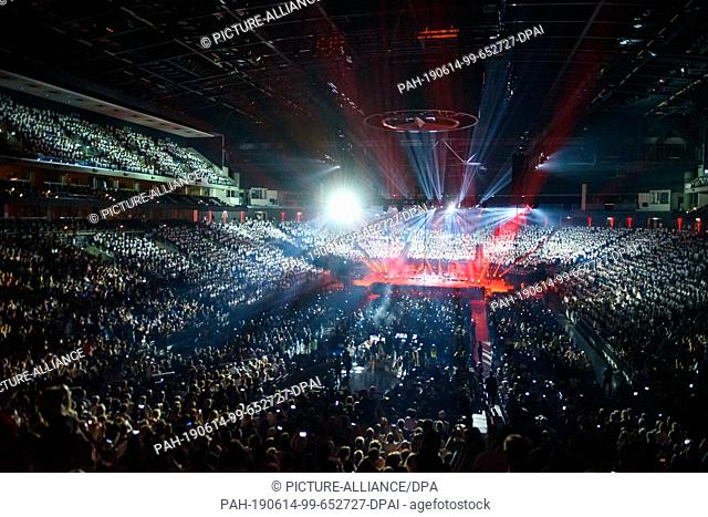 """14 June 2019, Berlin: Children and teenagers stand singing and dancing in the grandstand of the Mercedes-Benz Arena during the concert of """"""""6K United! The choir..."""