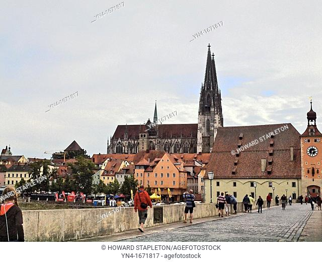 Dom St Peter the Regensburg Cathedral from the Old Stone Bridge  The clock tower arch marks the entrance to Old Town Regensburg