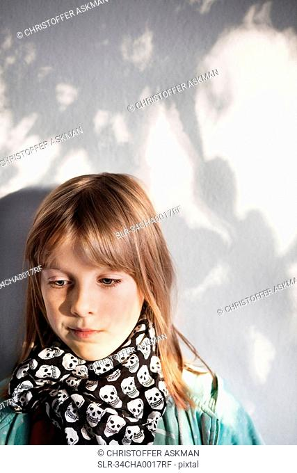 Girl wearing skull-pattern scarf