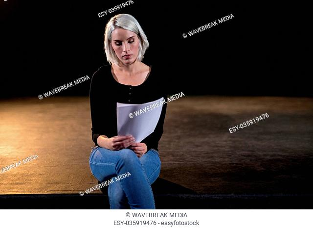 Actress reading her scripts on stage