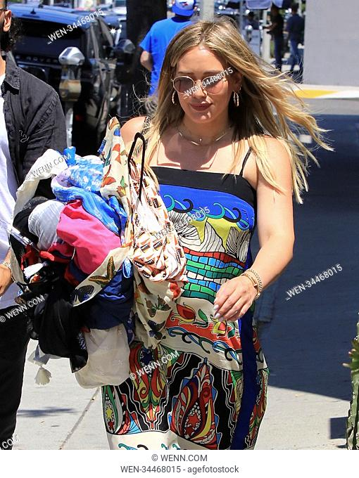 Hilary Duff wears a colourful dress while out in Beverly Hills, United States Featuring: Hilary Duff Where: Beverly Hills, California