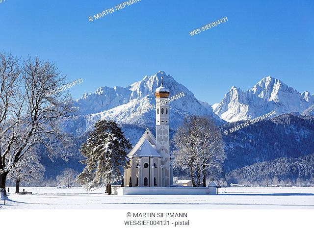 Germany, Bavaria, View of St Coloman Church in front of Tannheim Mountains