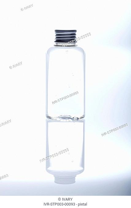 Bottle With Metal Cover And Reflection