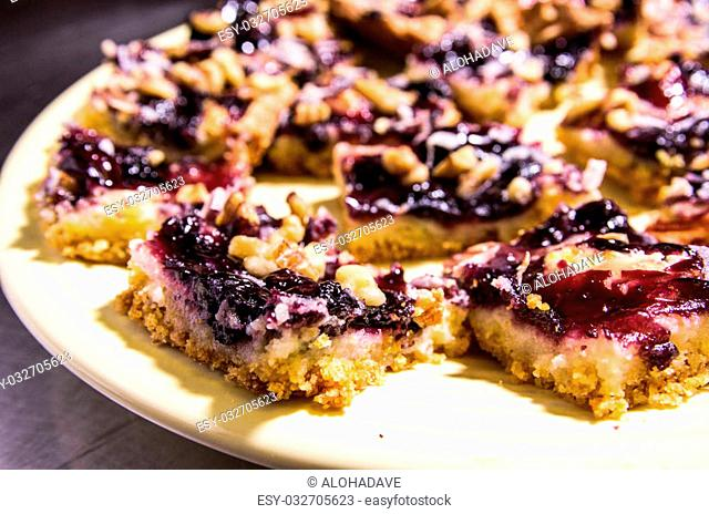 Blueberry crumble sliced and stacked on a plate, ready to be served