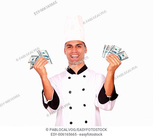 Portrait of a happy male in cook uniform holding money on white background
