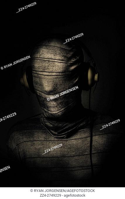 Dark Evil Monster Mummy Listing To Horror Rock Tunes On Earphone. Death Metal DJ Wrapper