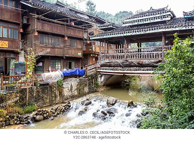 Zhaoxing, Guizhou, China, a Dong Minority Village. Wind and Rain Bridge Crossing Small River Running through the Village