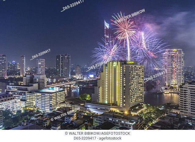 Thailand, Bangkok, Riverside Area, high angle skyline view with fireworks, dusk