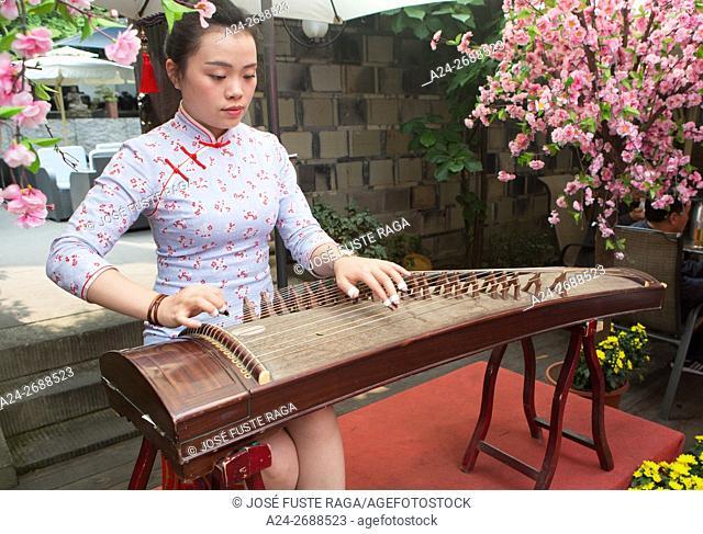 China, Sichuan Province, Chengdu City, Nanjiao Park, Woman Playing