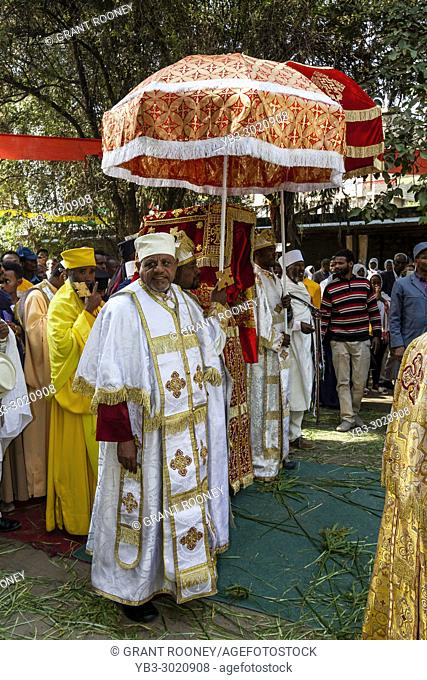 A Procession Of Orthodox Ethiopian Priests and Deacons Leaving Kidist Mariam Church During The Three Day Timkat (Epiphany) Celebrations, Addis Ababa, Ethiopia