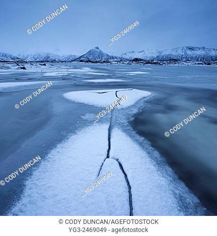 Snow and ice formations on frozen Vatnfjord in winter, Austvågøy, Lofoten Islands, Norway