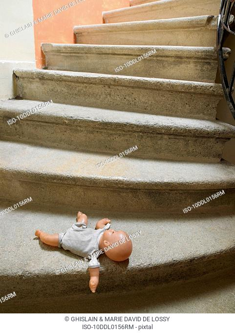 Doll on the stairs