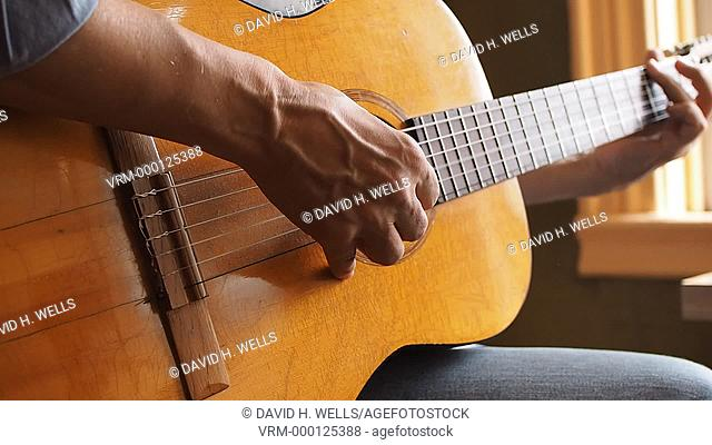 Hands of a musician playing guitar in Providence, Rhode Island