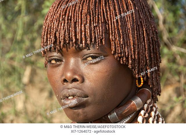 Portrait of a married Hamar woman with red clay in her hair, Omo river valley, Southern Ethiopia