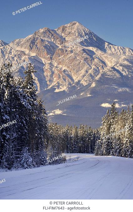 Snow covered Maligne road with Pyramid mountain in the background, Jasper National Park, Alberta