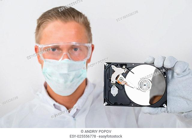 Portrait Of Young Technician Showing Hard Drive