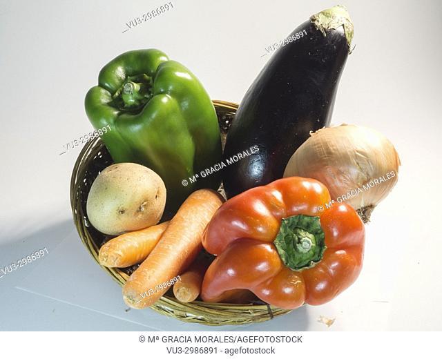 Basket of vegetables on white bakcground