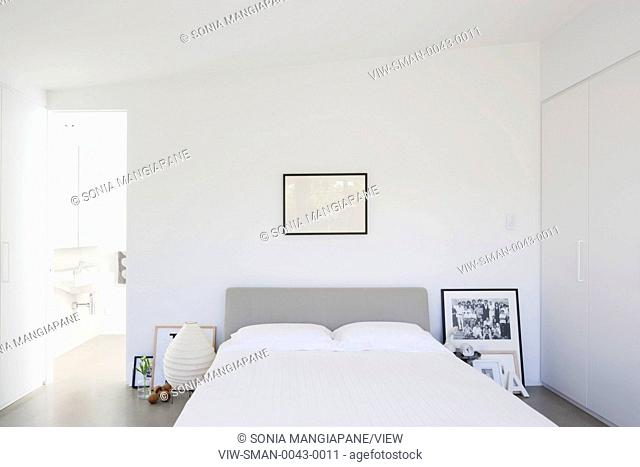 Master bedroom with view through to ensuite bathroom. Berkeley House Heidelberg, Melbourne, Australia. Architect: Luke Stanley Architects & Cameron Fry...