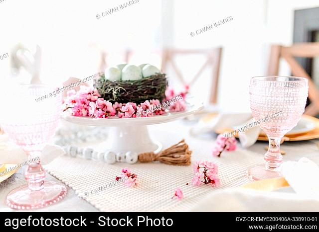 Close up of cherry blossom easter dining tablescape