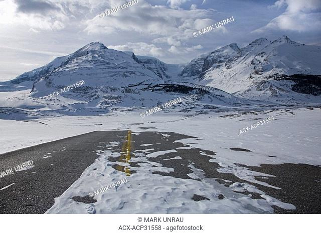 Deserted snow-covered highway into the Athabasca Glacier, Jasper National Park, Alberta, Canada