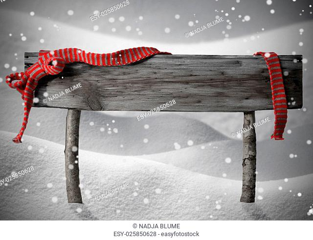 Gray Wooden Christmas Sign On White Snow. Snowy Scenery With Snowflakes. Red Ribbon, Copy Space For Advertisement. Christmas Decoration Or Christmas Card