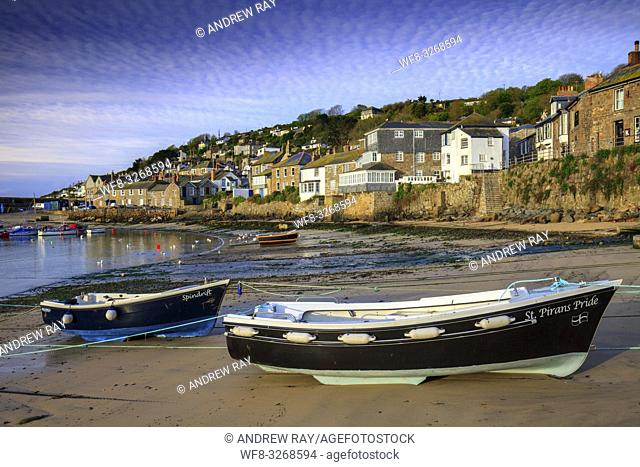 Boats in Mousehole Harbour on the western side of Mounts Bay in Cornwall, captured approximately an hour after sunrise in late April